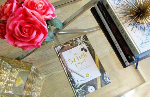 Coffee table scene at Ash Tree Grove, with The 52 Lists Project and roses.