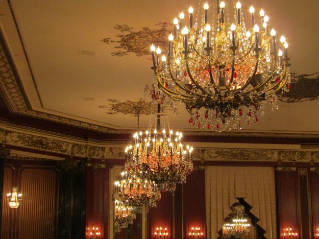 The Red Lacquer Ballroom at the Palmer House in Chicago. Check out those chandeliers!